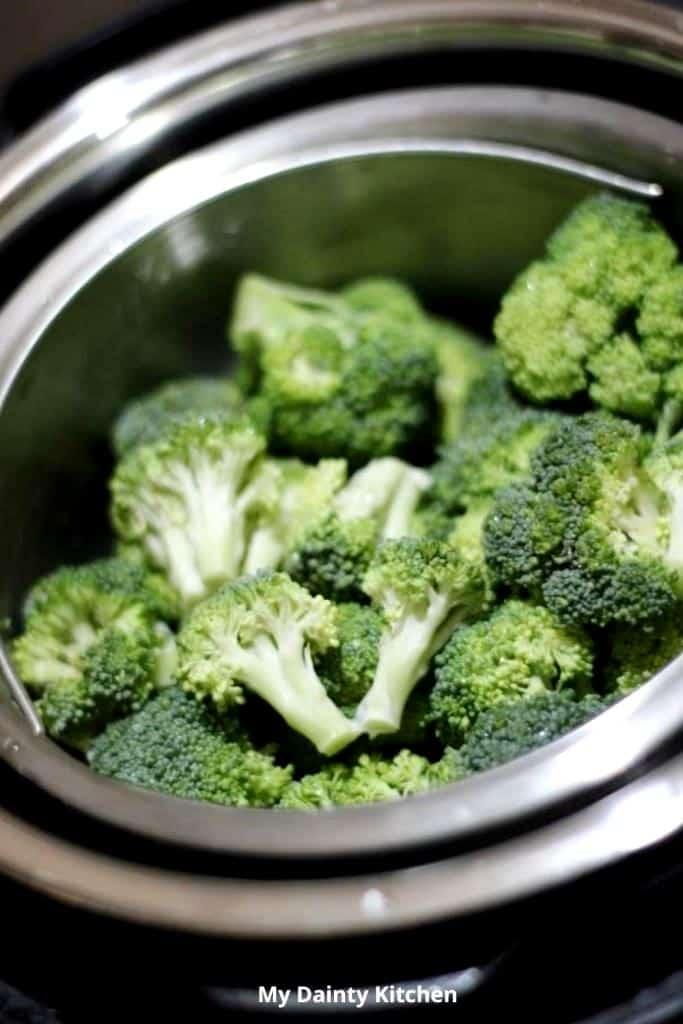 broccoli florets placed inside the instant pot steamer